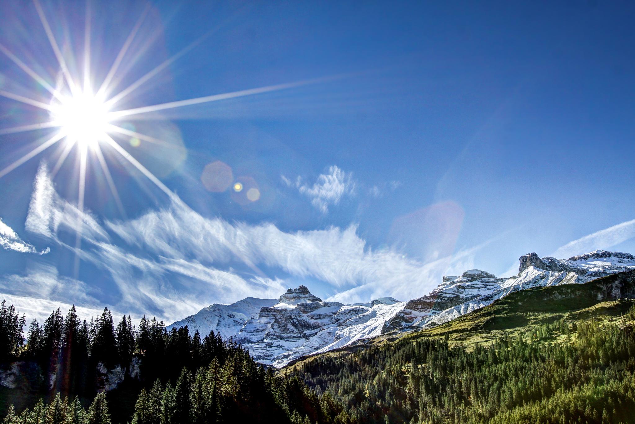 красивые картинки солнца в горах под