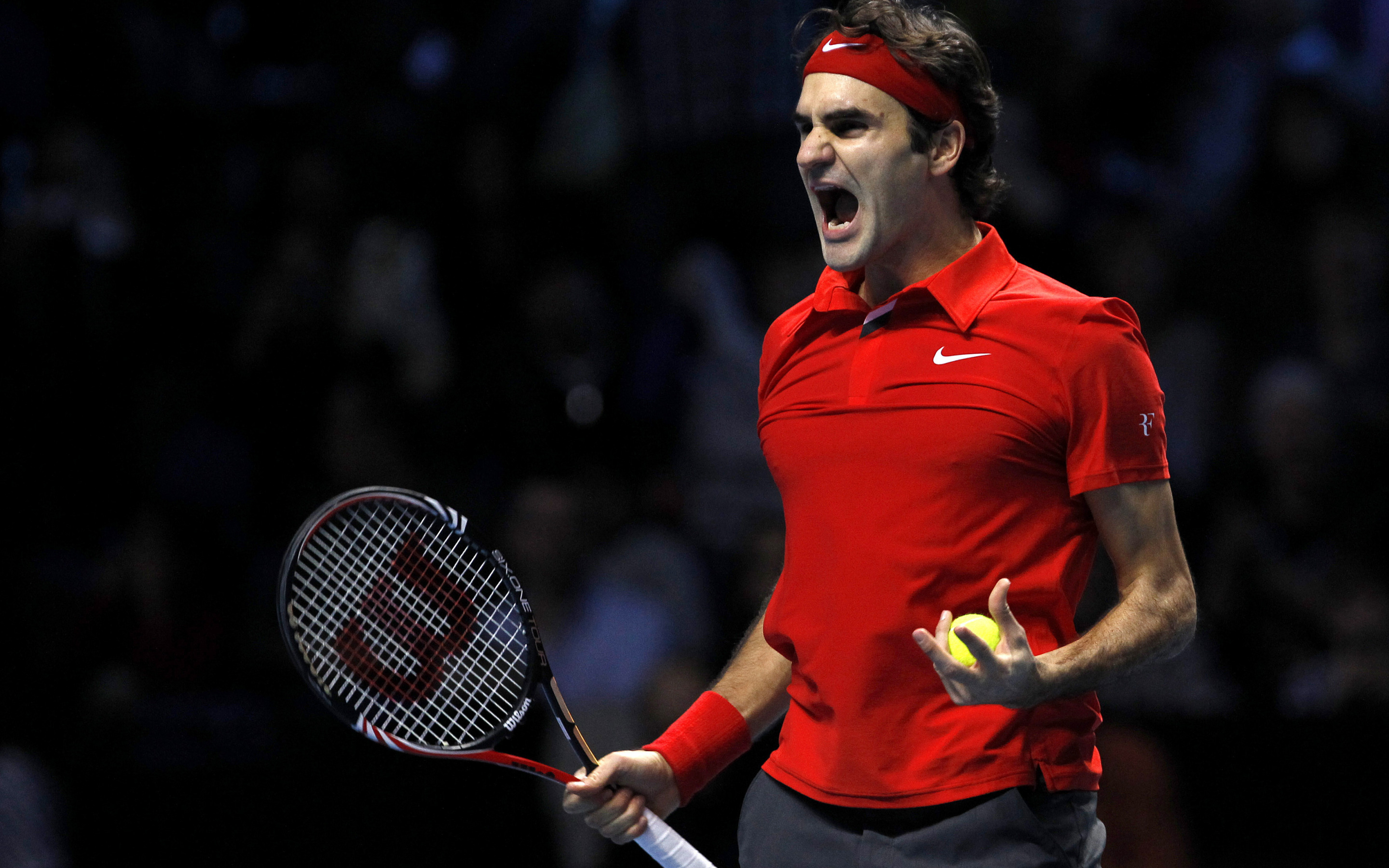 titillating tennis player can't believe the size of his racket  85372