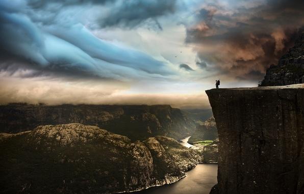 Картинка небо, пейзаж, горы, тучи, скала, река, обрыв, человек, Norway, Preikestolen, photo by Robin Kamp