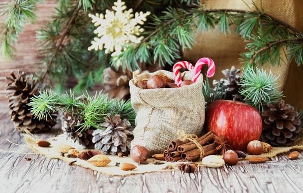 Картинка ветки, праздник, новый год, яблоко, рождество, конфеты, орехи, корица, мешок, хвоя, шишки, мешковина, специи