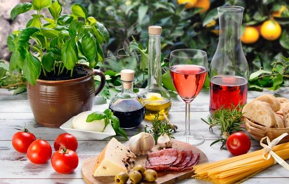 Картинка стол, вино, красное, бокал, масло, еда, сыр, хлеб, овощи, помидоры, оливки, спагетти, колбаса, чеснок
