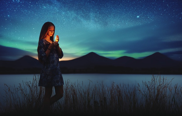 Картинка lights, girl, grass, dress, night, mountains, lake, stars, candle, milky way, northern lights, peaks, silhouettes, …