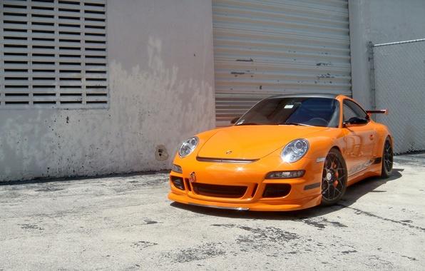 Картинка оранжевый, стена, здание, 997, ограждение, wheels, porsche, порше, orange, gt3 rs, гт3 рс, роллеты