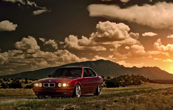 Картинка небо, солнце, облака, закат, горы, бмв, BMW, red, блик, красная, front, E34, 5 Series