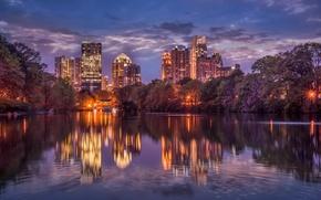 Картинка небо, облака, деревья, ночь, город, огни, отражение, река, дома, небоскребы, освещение, USA, США, river, trees, …