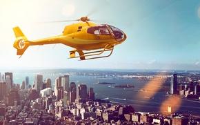 Картинка небо, полет, пейзаж, желтый, город, река, дома, небоскребы, вертолет