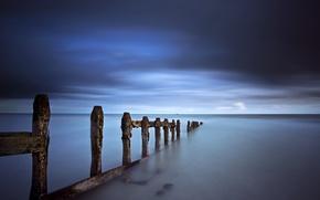Обои гроза, небо, тучи, синева, берег, Море, опоры