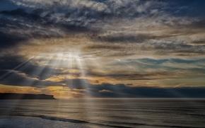 Картинка море, тучи, скала, солнечные лучи