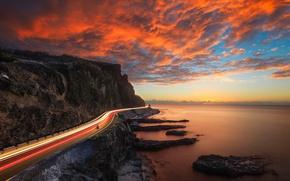 Обои дорога, небо, свет, закат, огни, скалы