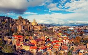 Обои Грузия, Tbilisi, мосты, горы, дома, крепость, облака, солнце, небо, скалы, река, пейзаж