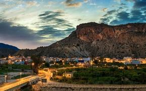 Картинка дорога, закат, горы, мост, скалы, дома, вечер, городок, Испания, Ulea