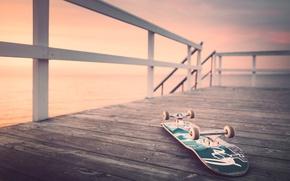 Картинка море, пирс, восход, скейтборд