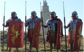 Картинка трава, башня, доспехи, холм, мечи, щиты, дротики, шлемы, римские легионеры, военно-историческая реконструкция, туники, обувь «калиги»