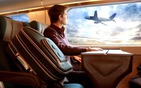 Обои самолет, иллюминатор, парень, поездка, багаж