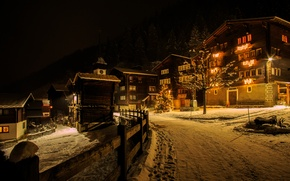 Картинка зима, дорога, снег, ночь, огни, забор, новый год, дома, Швейцария, ёлка, гирлянда, Niederwald