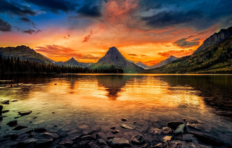 Фото обои лес, небо, деревья, закат, горы, озеро, камни, зарево, США, Glacier National Park, Two Medicine Lake