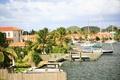 Картинка город, дома, яхты, причалы, Карибы