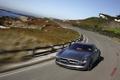 Картинка Mercedes, benz, sls, amg, дорога, скорость, забор, камни