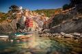 Картинка Италия, дома, бухта, лодки, Лигурийское побережье, Риомаджоре, небо, скалы, Чинкве-Терре