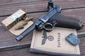 Картинка Пистолет, патроны, документ