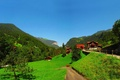 Картинка Швейцария, велосипед, страна, дома, деревья, Берн Лаутербруннен, день, дорога, art, человек, Город, лето, трава, пейзаж