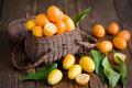 Картинка Anna Verdina, фрукты, оранжевые, корзинка, кумкват, цитрусы, листья