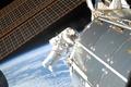 Картинка Земля, космонавт, МКС, солнечные батареи, модуль, планета, космос