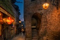 Картинка street, street lights, arch, France, Mont Saint Michel, portal, lights, stairs, lamps, people, night, signs, ...